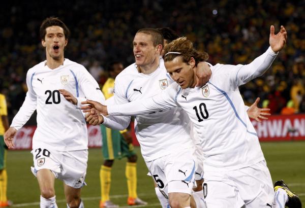 Forlan celebrates his goal.